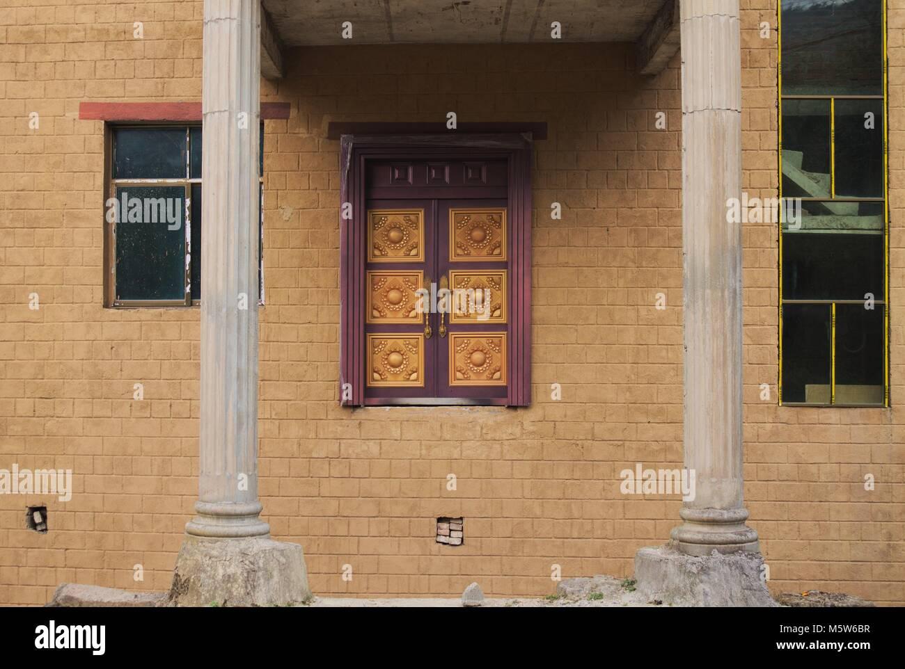 Porta di ingresso senza scale (Yunnan, Cina) Immagini Stock