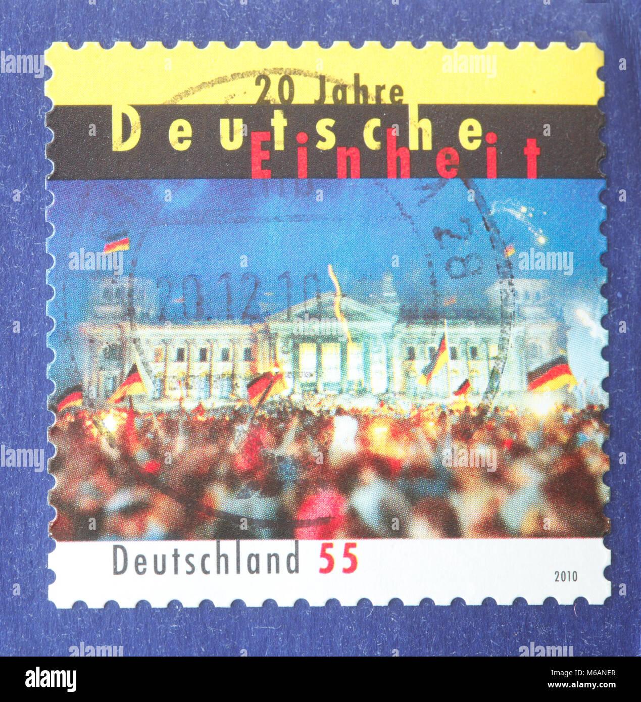 Il tedesco stampigliato Francobollo venti anni Reunion tedesco su una busta Immagini Stock