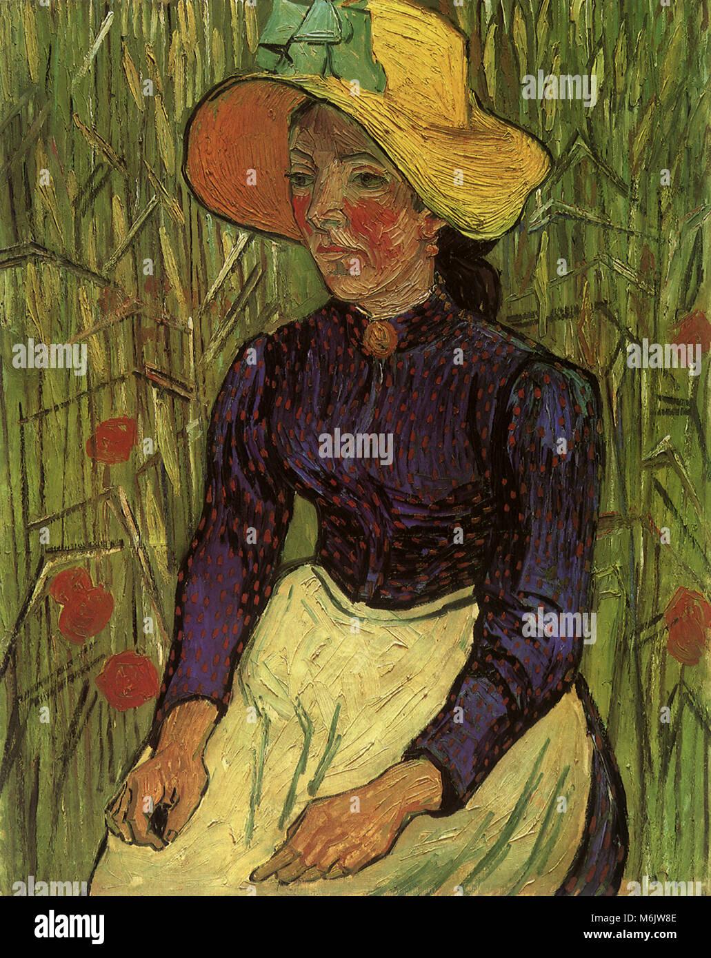 Giovane contadino di donna con cappello di paglia in seduta il frumento 3866529ee382