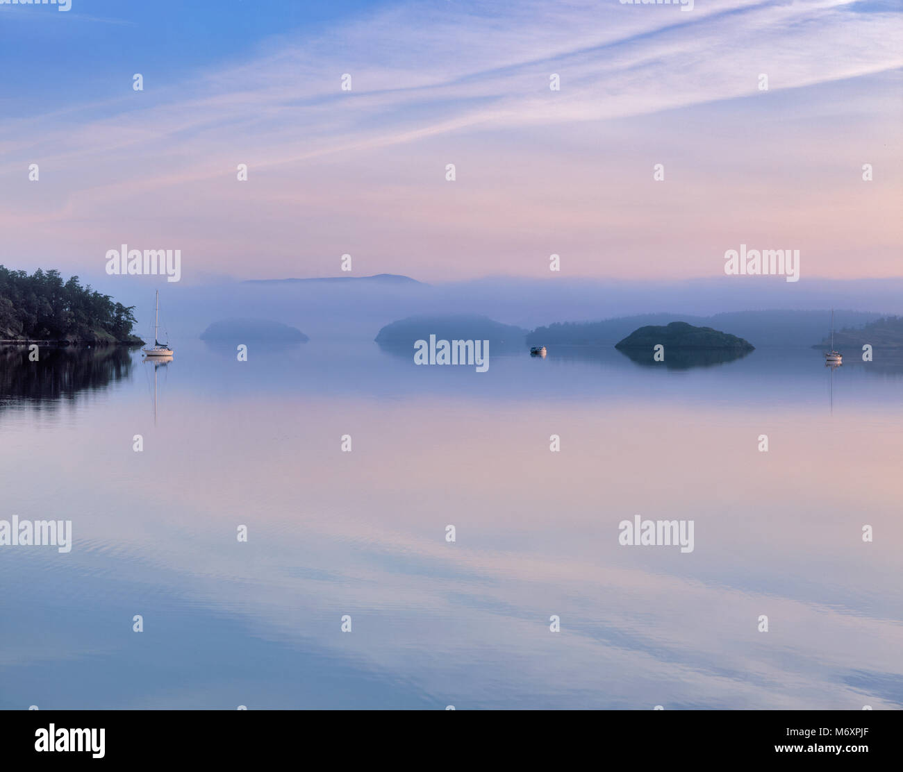 Dawn, Mud Bay, Lopez Island, le Isole San Juan, Washington Immagini Stock