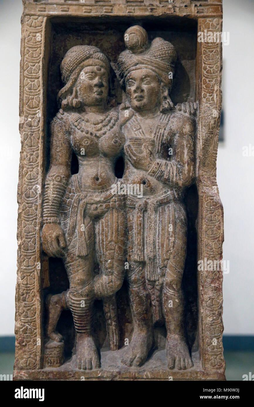 Museo Nazionale dell'India, New Delhi. Coppia amorosa. Sunga. 2° secolo. Amin, Haryana. La pietra. Dettaglio. India. Immagini Stock