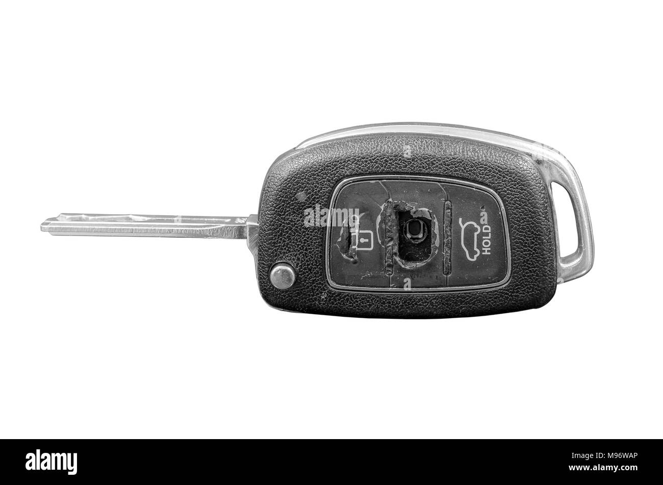 Close-up del danneggiamento di una chiave auto isolati su sfondo bianco. Immagini Stock