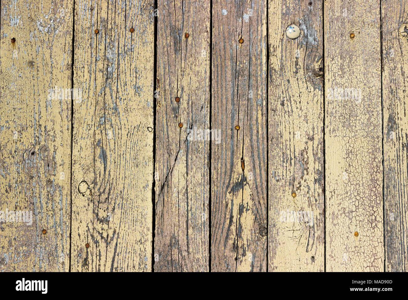 Colori Vernici Legno : Sfondo di assi di legno con una mostarda incrinato di vernice di