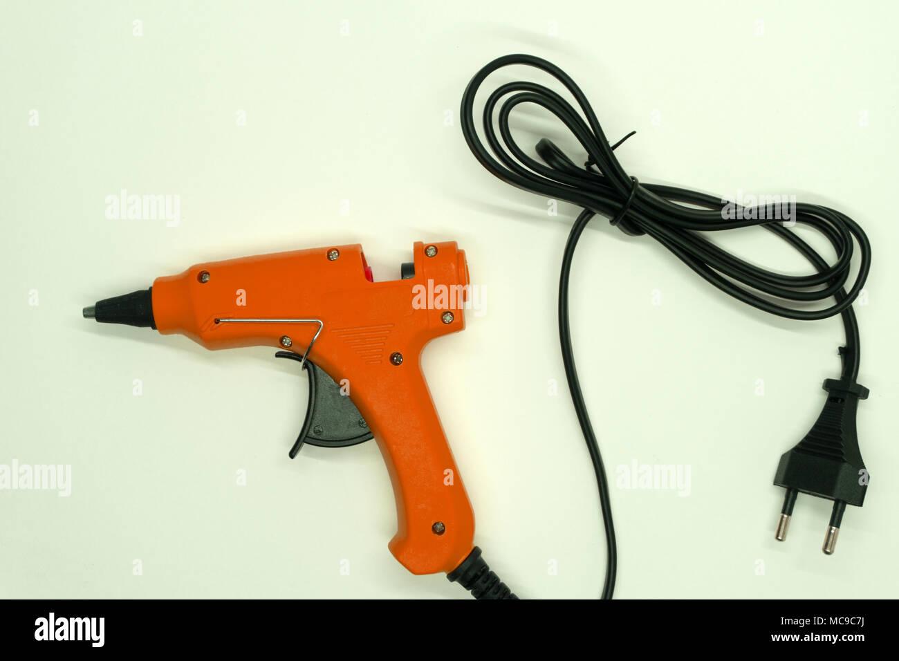 Pistola per colla a caldo stick adesivo bianco utensile Immagini Stock
