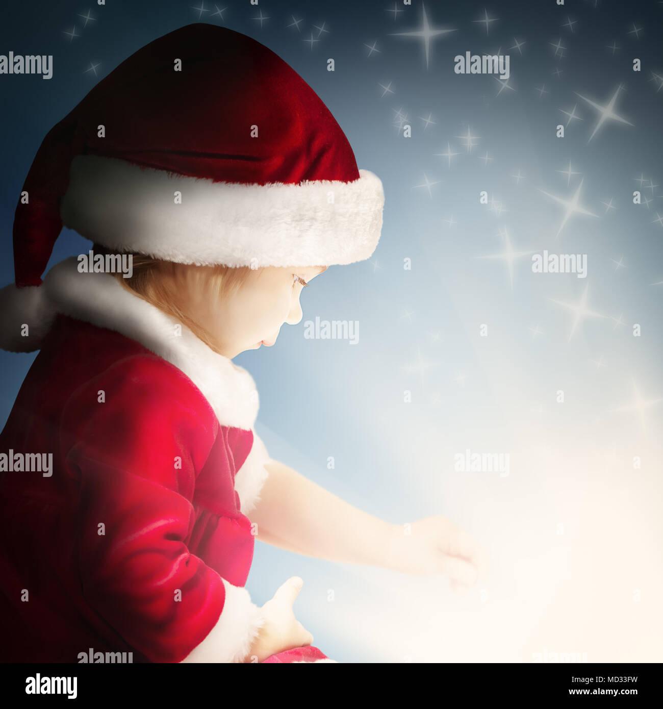 Natale bambino regalo aperto sullo sfondo con Sparkle e Glitter