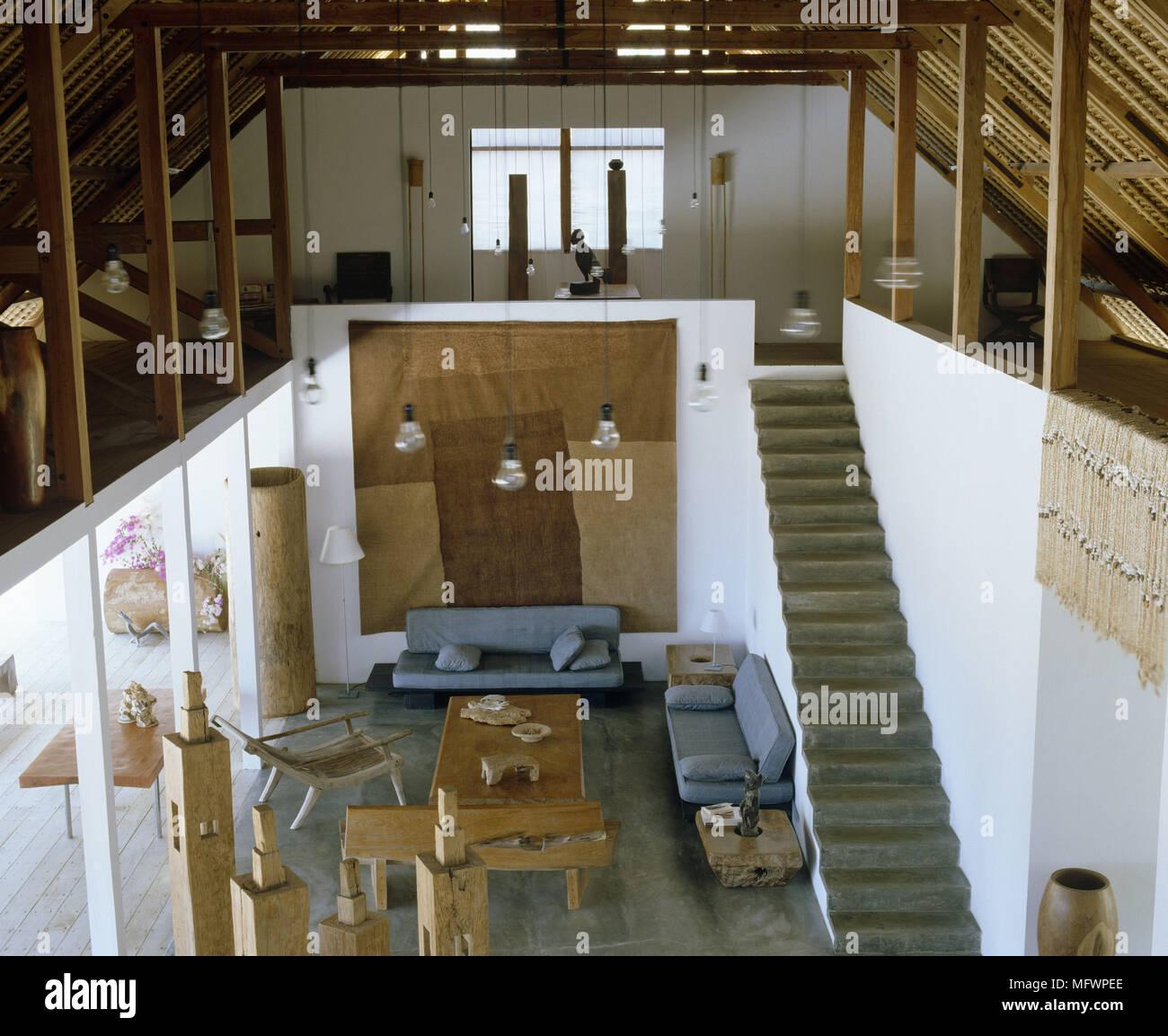 Soggiorno Con Pietra A Vista vista in elevazione di area soggiorno a piano aperto con
