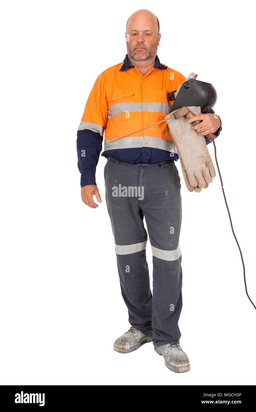 Un lavoratore guardando in giù con un espressione triste, isolato su bianco. Immagini Stock