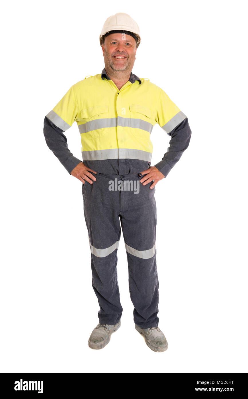 A piena lunghezza Ritratto di lavoratore manuale posa sul bianco. Immagini Stock