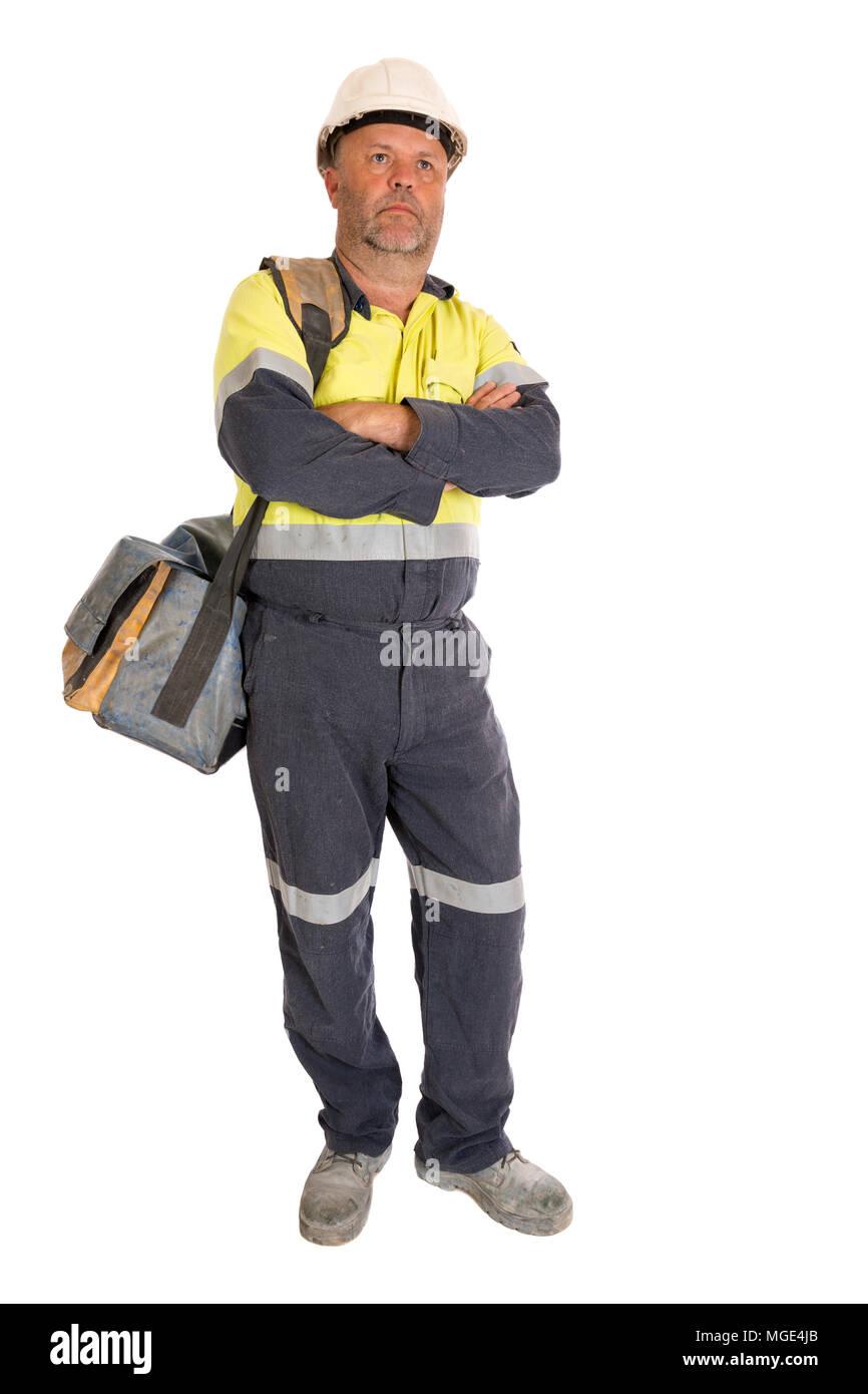 Una lunghezza completa immagine di un reale e normale lavoratore manuale, in piedi in una posa rilassata. Immagini Stock