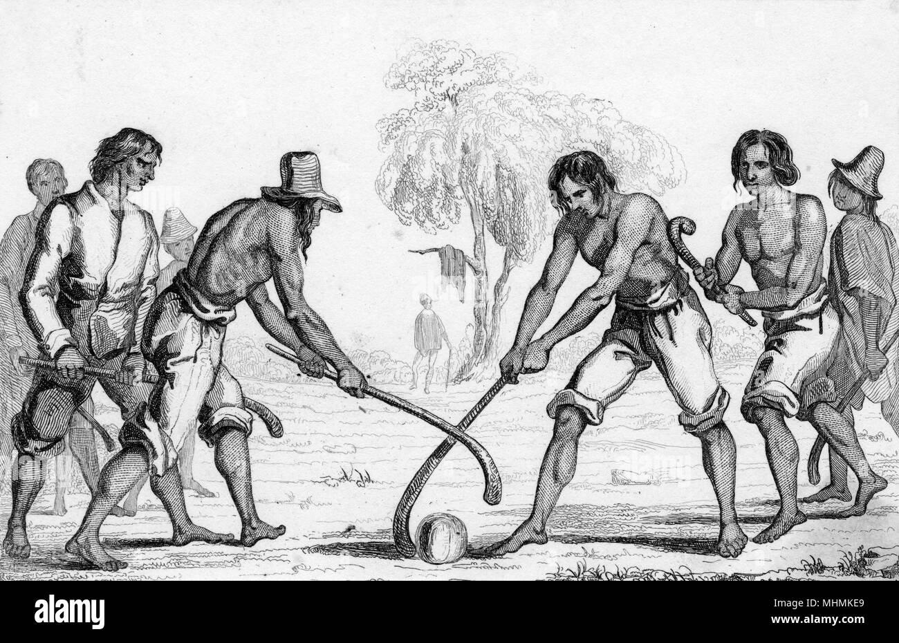 Cileni giocano un prima forma di hockey. Data: circa 1835 Immagini Stock
