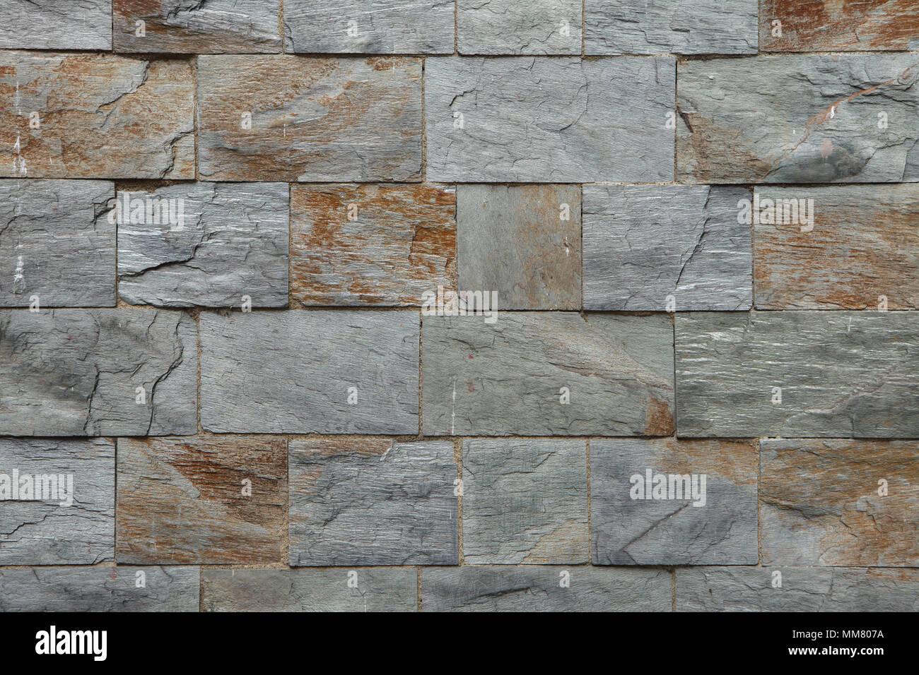 Facciata in pietra piastrelle. texture di sfondo foto & immagine