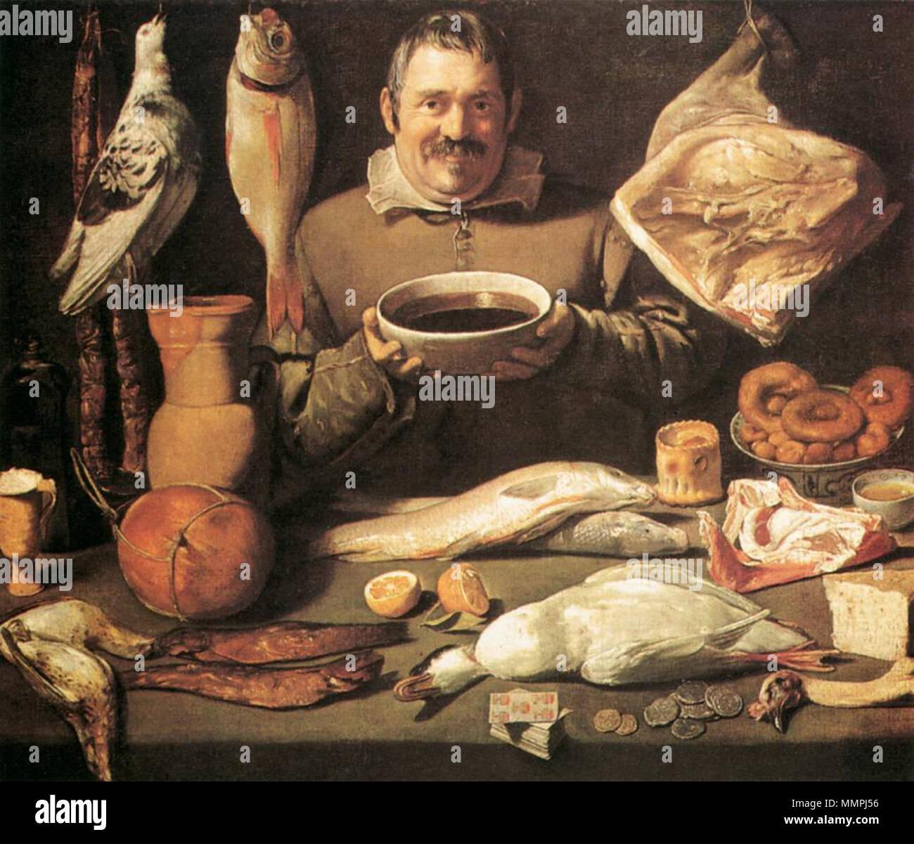Cucina di scena Bodegón. La risata di chef di cucina tenendo un grande  ciotola . 1156c13b6299