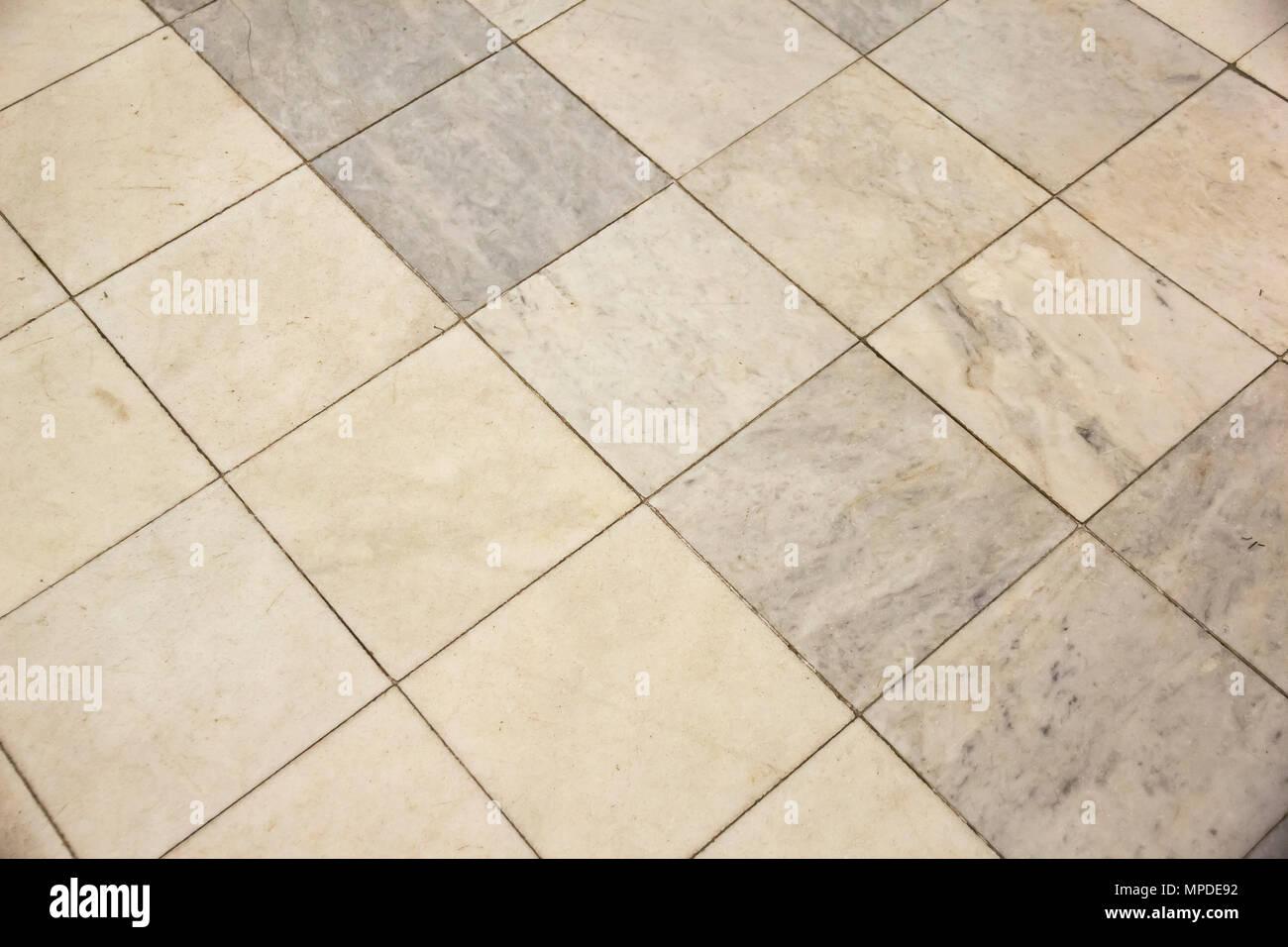 Quadrato di luce beige e grigio piastrelle per pavimento foto