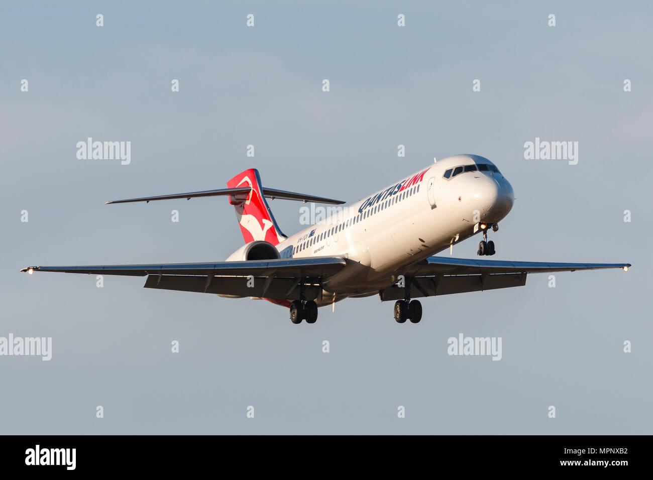 QantasLink Boeing 717-2BL aeromobile VH-YQV sull approccio all'Aeroporto Internazionale di Melbourne. Immagini Stock