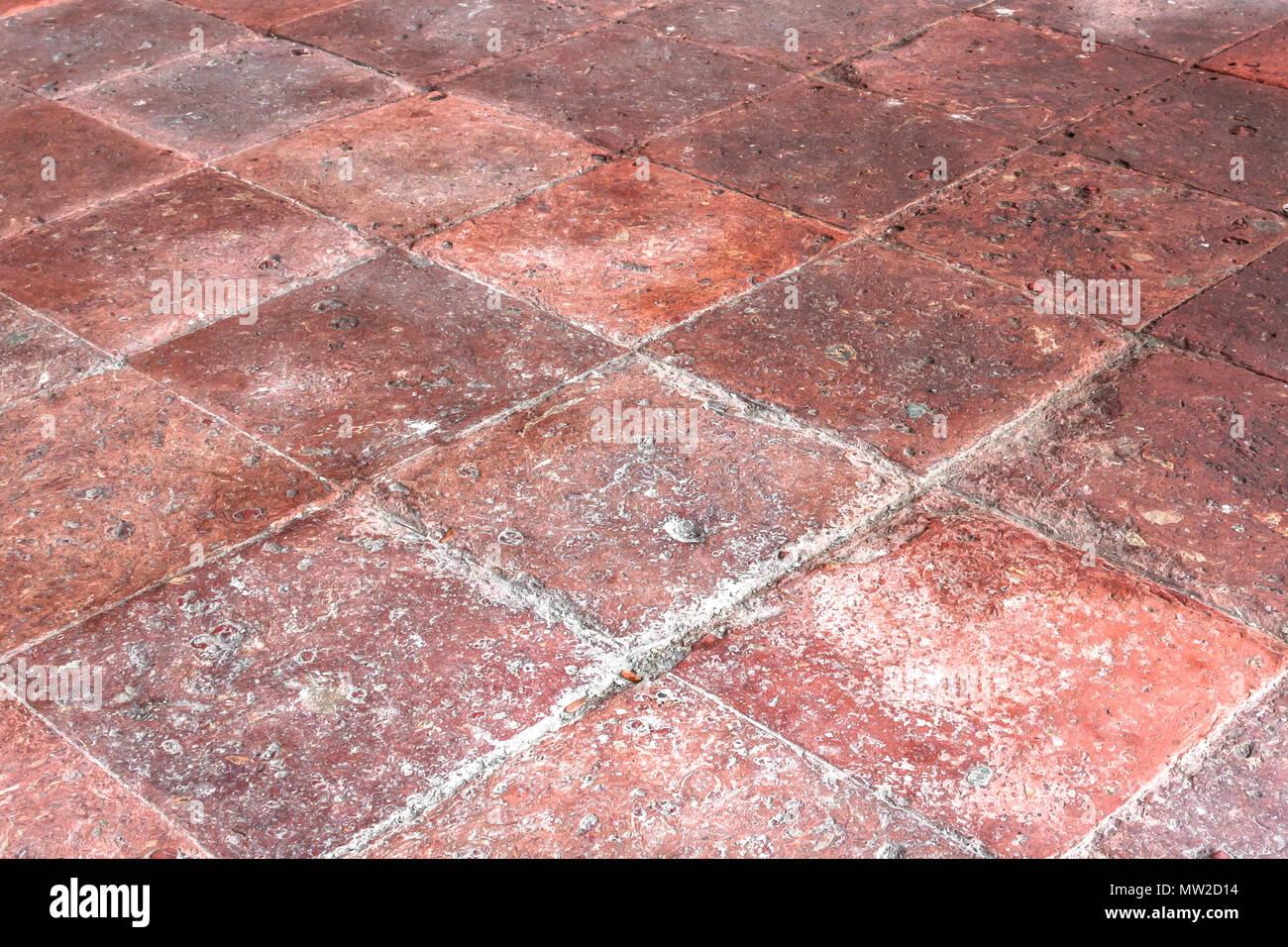 Pavimenti in cotto. marrone e rosa pavimenti con mattonelle di