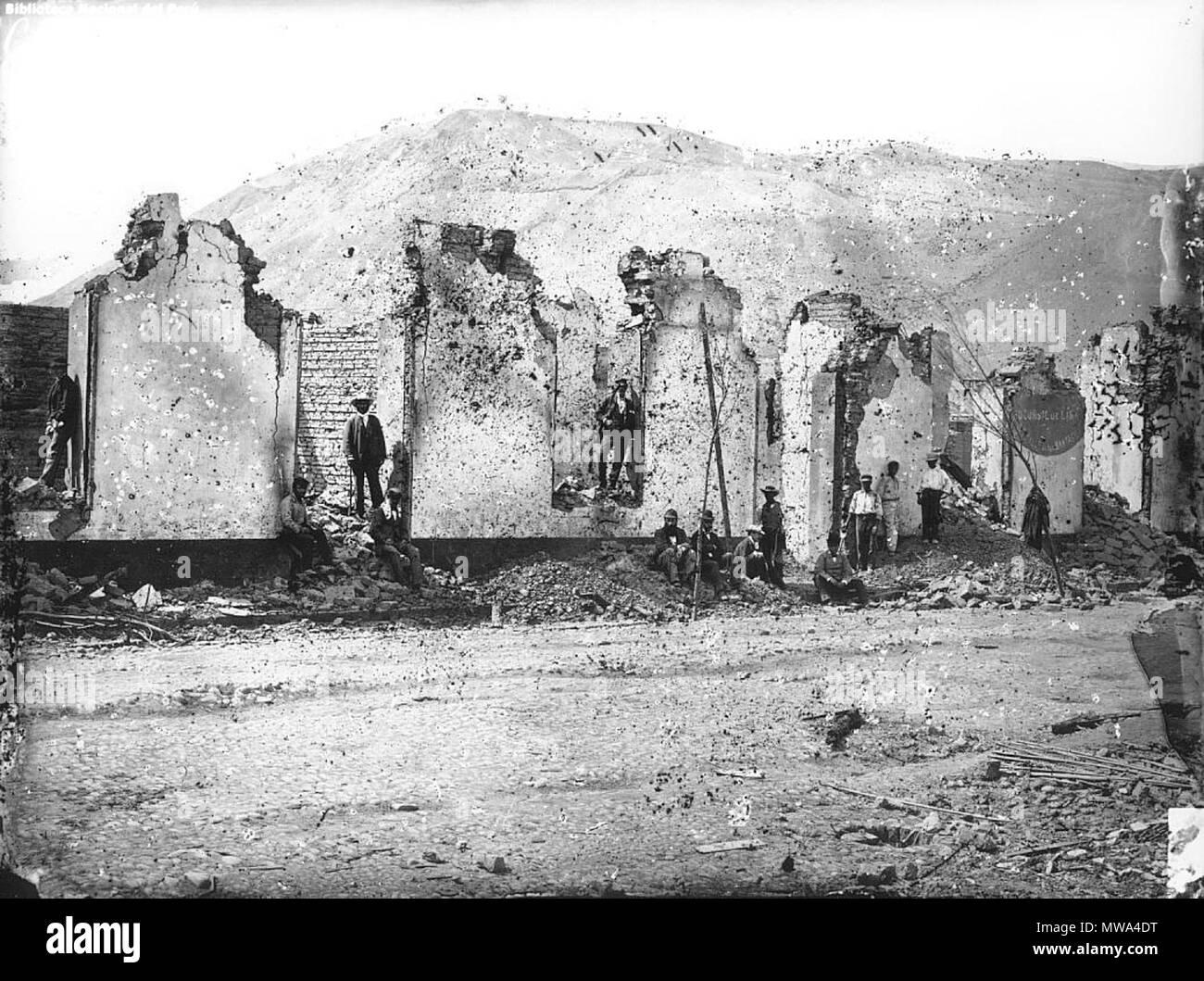 . Chorrilos (Destruido por los Chilenos). Vista de los efectos de la invasión chilena en el pueblo deChorrillos, luego de la derrota de las Fuerzas peruanas en la batalla de San Juan (1881). Ejemplar en positivo en F/985.061/CH Y76/1 CU:2/31A. http://courret.perucultural.org.pe/muestraimagen.asp?imagen=09F0108&nitem=1&tipoimagen=V&numid=88344812 . Chorrilos 1881. Eugéne Courret 128 Chorrilos Courret 1881 Immagini Stock