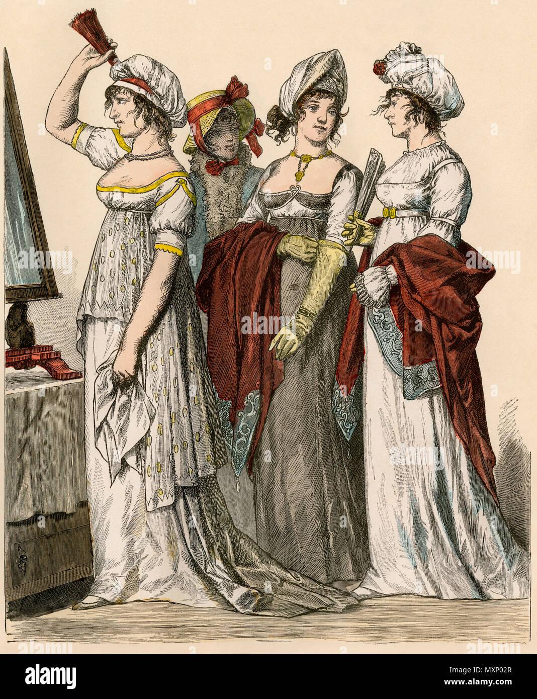 Francese e Tedesco ladies in stile impero abiti, 1802-1804. Colorate a mano la stampa Immagini Stock