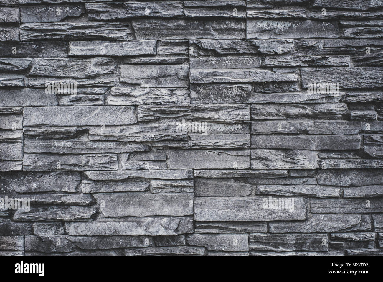 Muro di pietra naturale sfondo grigio pietra di granito texture