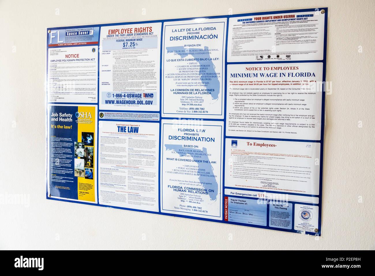 Florida Miami poster firmare i diritti dei lavoratori Discriminazione Inglese Spagnolo salario minimo informazioni Immagini Stock