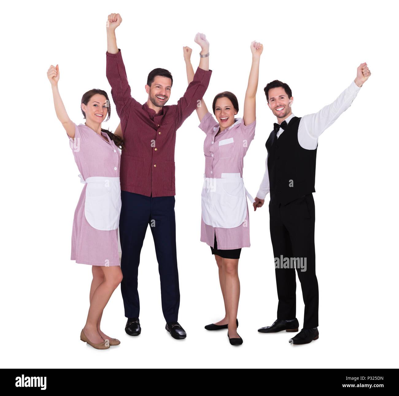 Happy Staff giovane alzando le braccia su sfondo bianco Immagini Stock