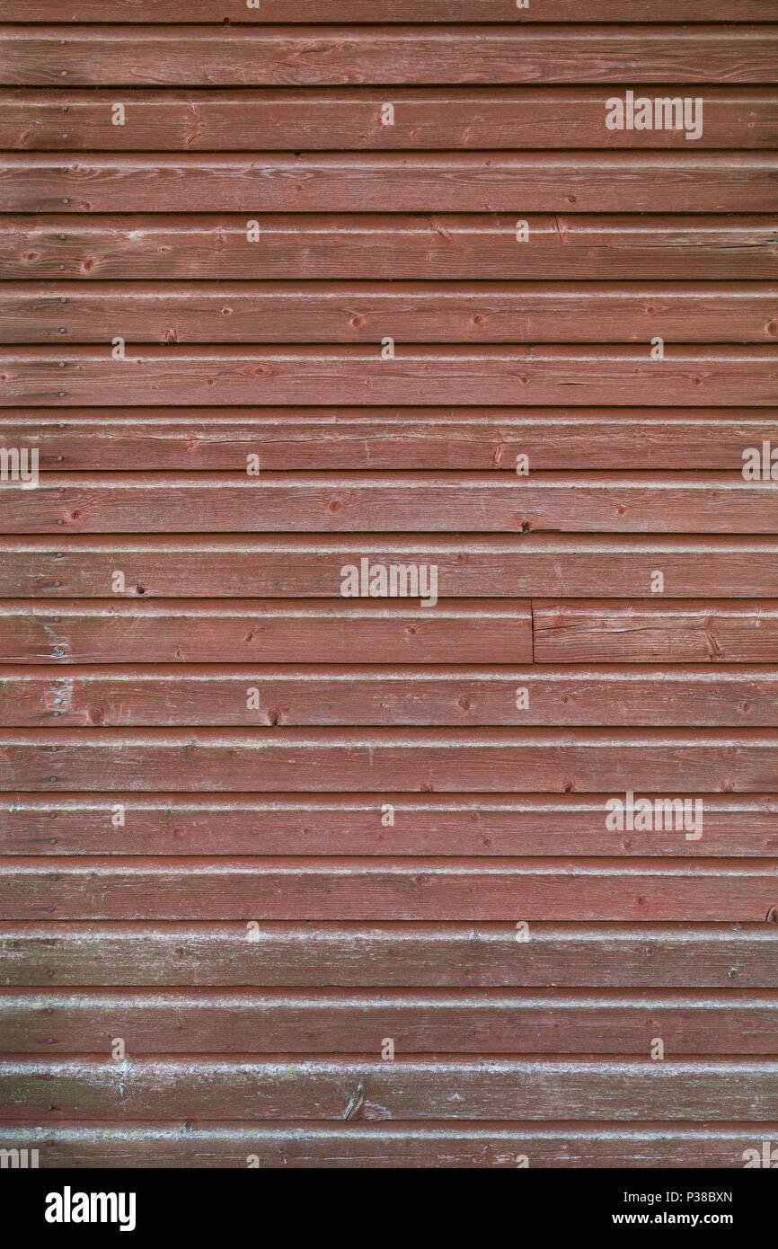 Telaio completo sullo sfondo di un vecchio sbiadito e pannello di legno muro  dipinto in rosso 3844dc677f08