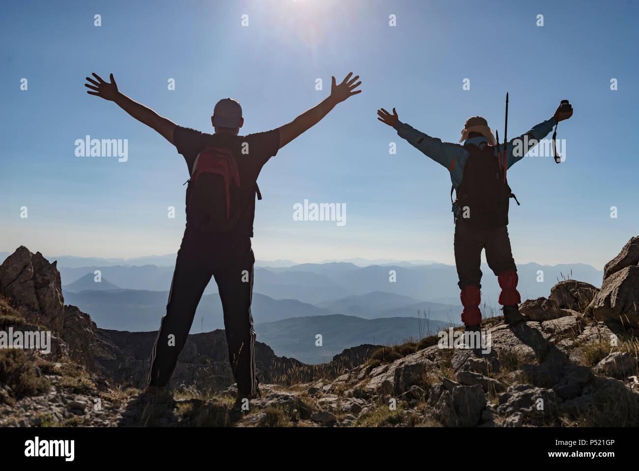 Felice e gioiosa alpinisti Immagini Stock