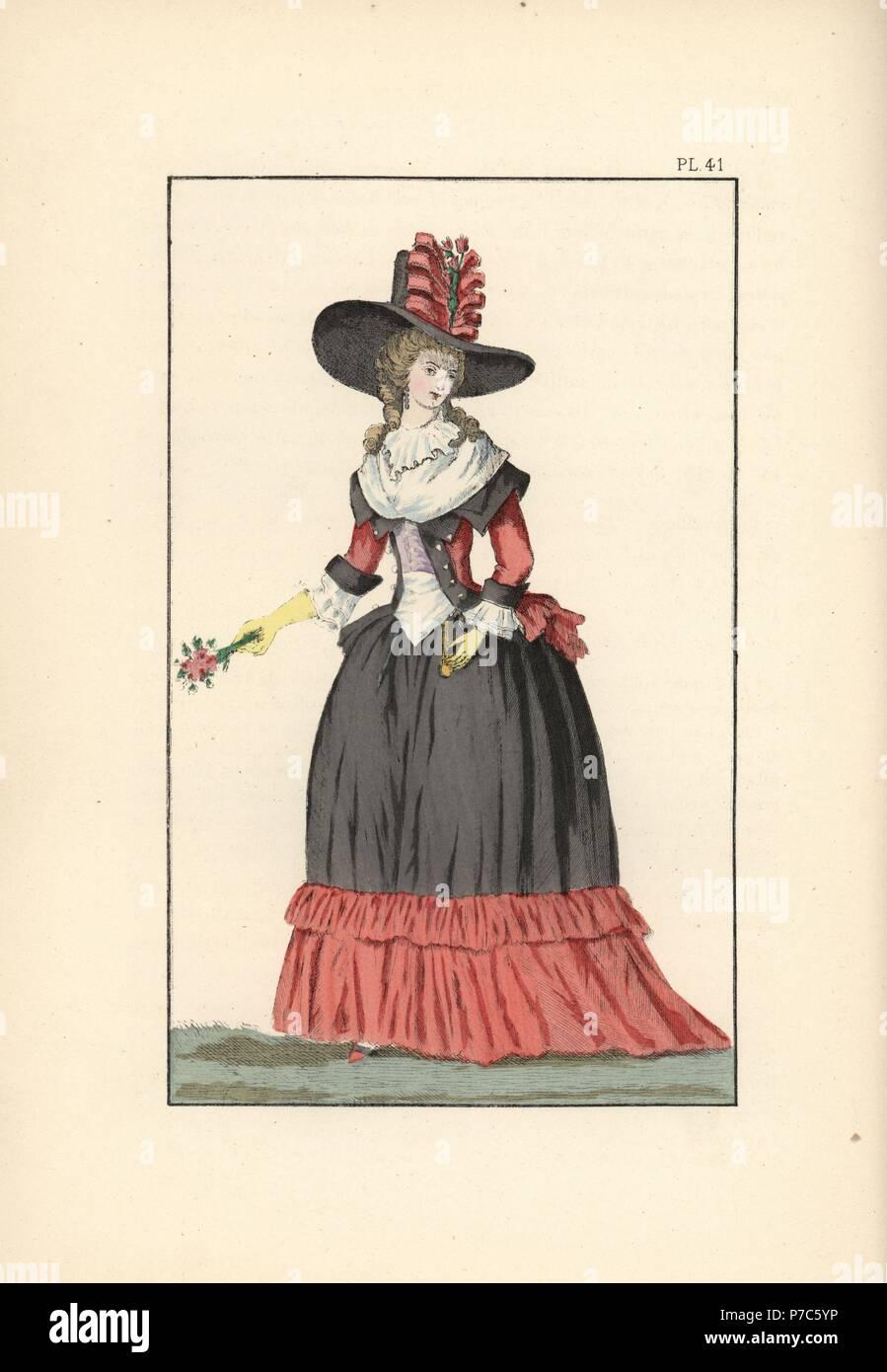 Donna in grande cappello in feltro nero con un papavero-nastro rosso cce6eff8eb61
