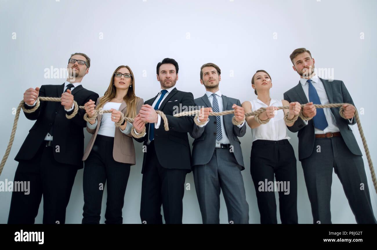 Le mani di uomini di affari con una corda Immagini Stock