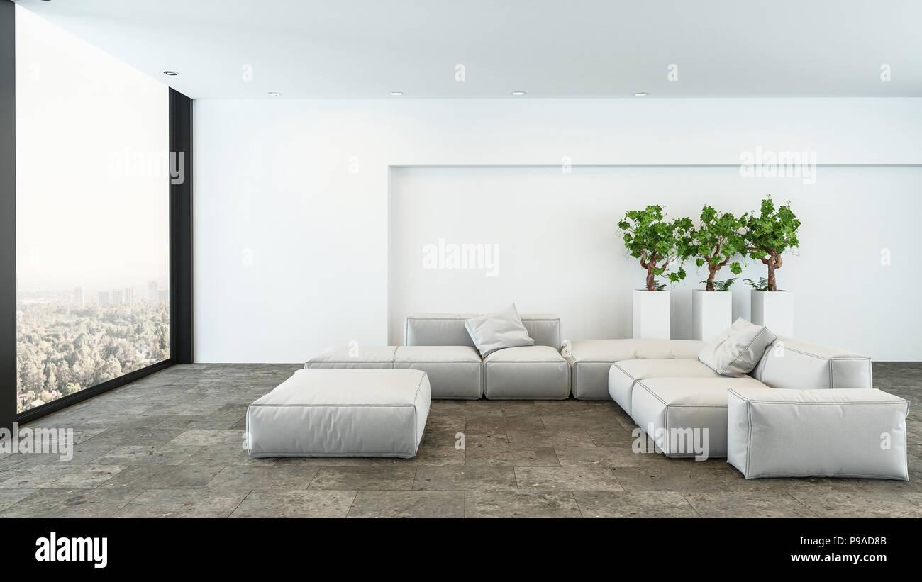 Area soggiorno con bianchi divani componibili e tre vasi di piante