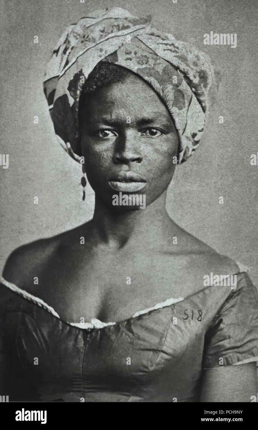 Alberto Henschel - Negra com turbante. Immagini Stock