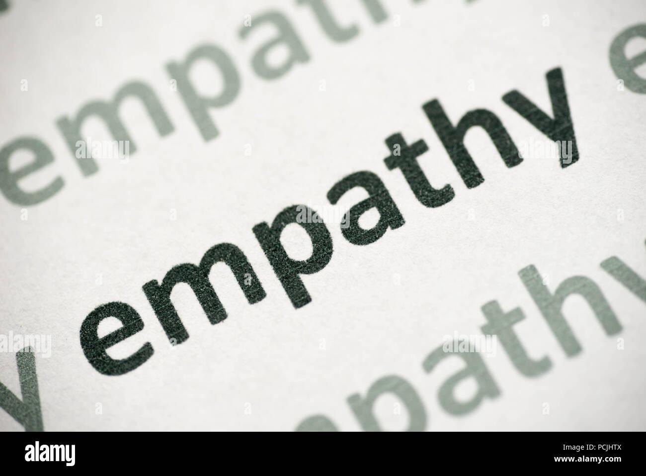 Parola empatia stampato su carta bianca macro Immagini Stock