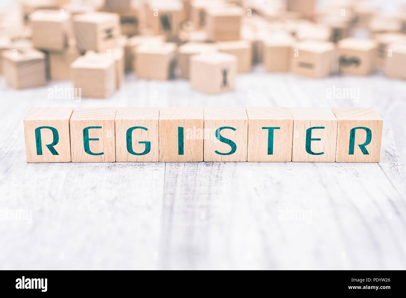 Il registro di parola formata da blocchi di legno su un tavolo bianco, concetto di promemoria Immagini Stock