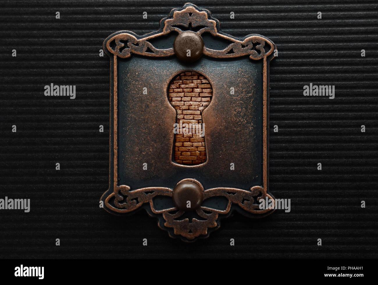 Antique keyhole brickwall con blocco Immagini Stock
