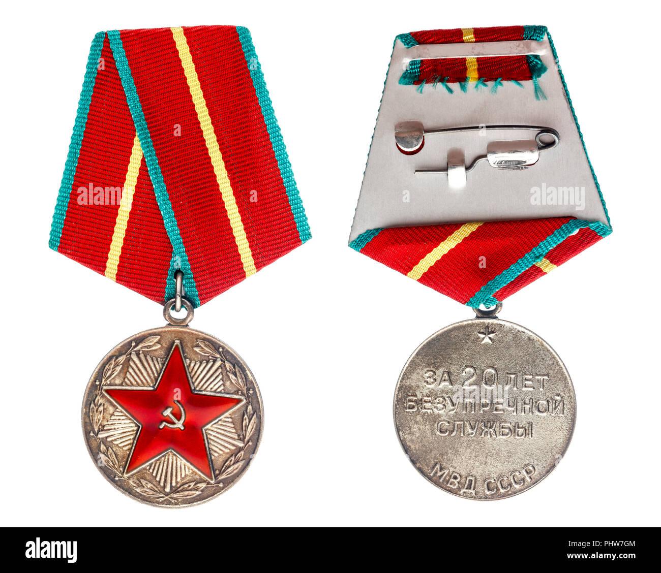 """Medaglia sovietica """" per venti anni di servizio impeccabile'. Isolare su sfondo bianco Immagini Stock"""