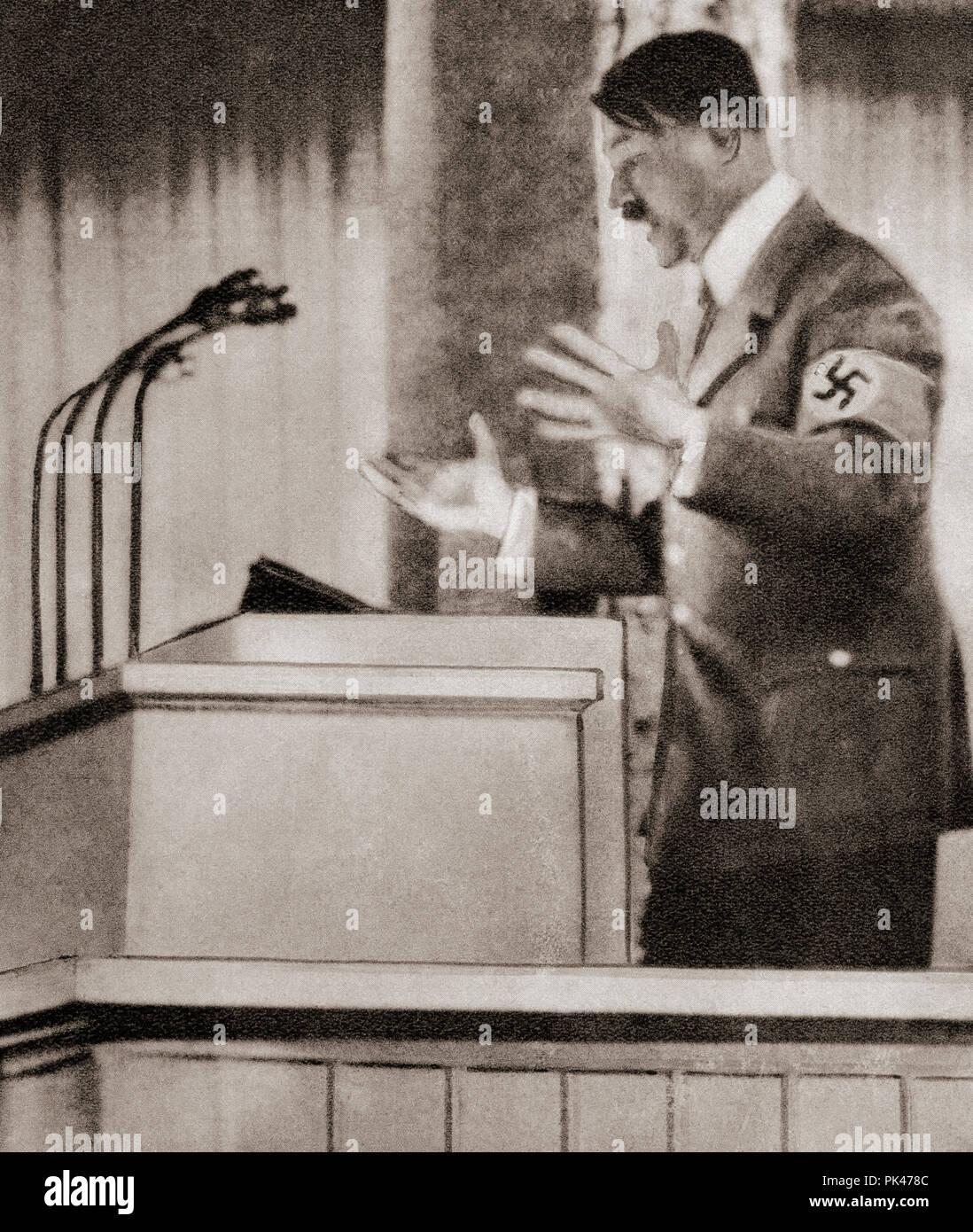 Adolph Hitler il discorso al rally di Norimberga, Settembre 12, 1938 dichiarando che l oppressione dei tedeschi dei Sudeti deve finire. Adolf Hitler,1889 - 1945. Uomo politico tedesco, demagogo, Pan-German rivoluzionario, leader del partito nazista, Cancelliere della Germania e il Führer della Germania nazista dal 1934 al 1945. Da questi straordinari anni, pubblicato in 1938. Immagini Stock