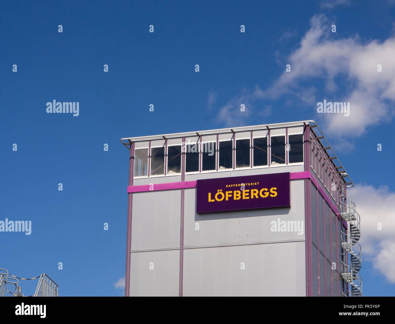 Caffè Löfbergs roastery a Karlstad Värmland Svezia har stati in attività dal 1906, marchio su industriale edificio a torre Immagini Stock
