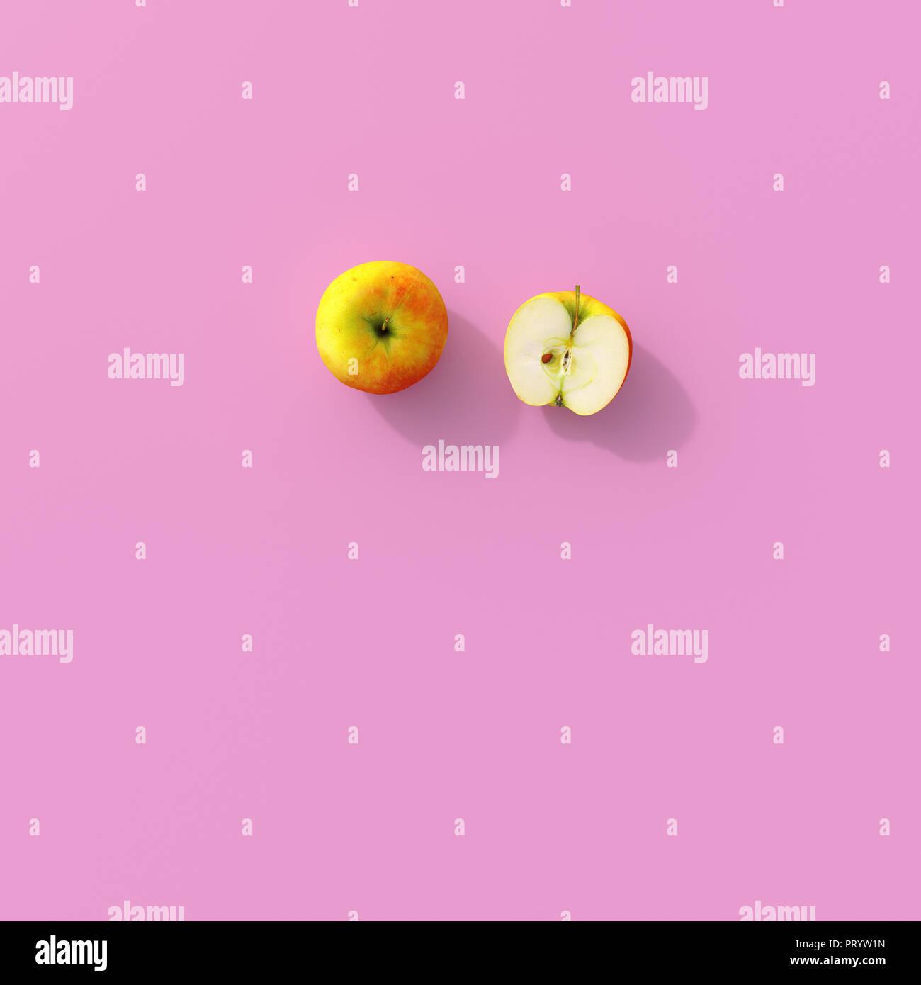 3d Rendering Dimezzato Apple Su Sfondo Rosa Foto Immagine Stock