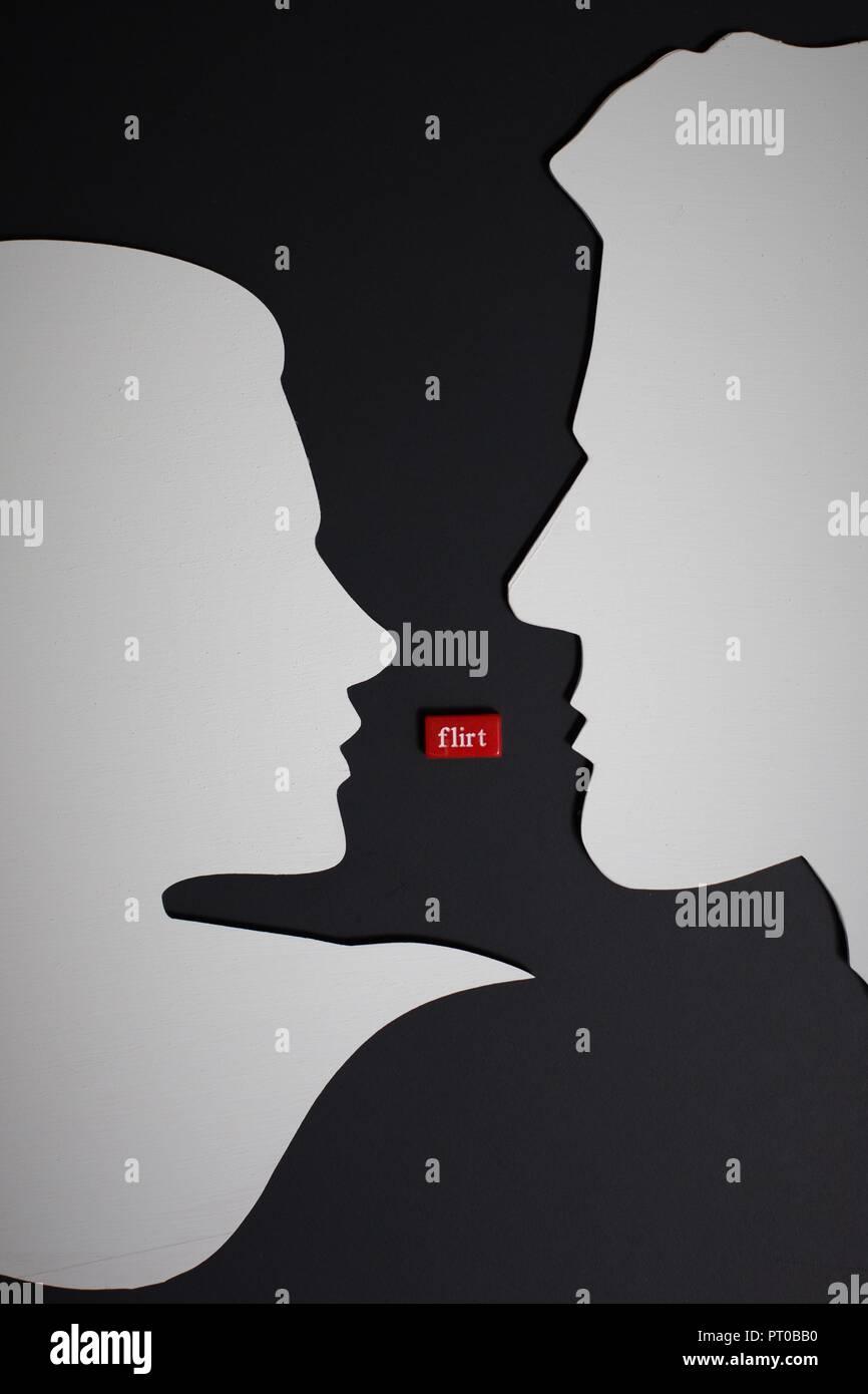 """Silhouette di uomo e di donna con la parola """"flirt"""" tra loro. Immagini Stock"""