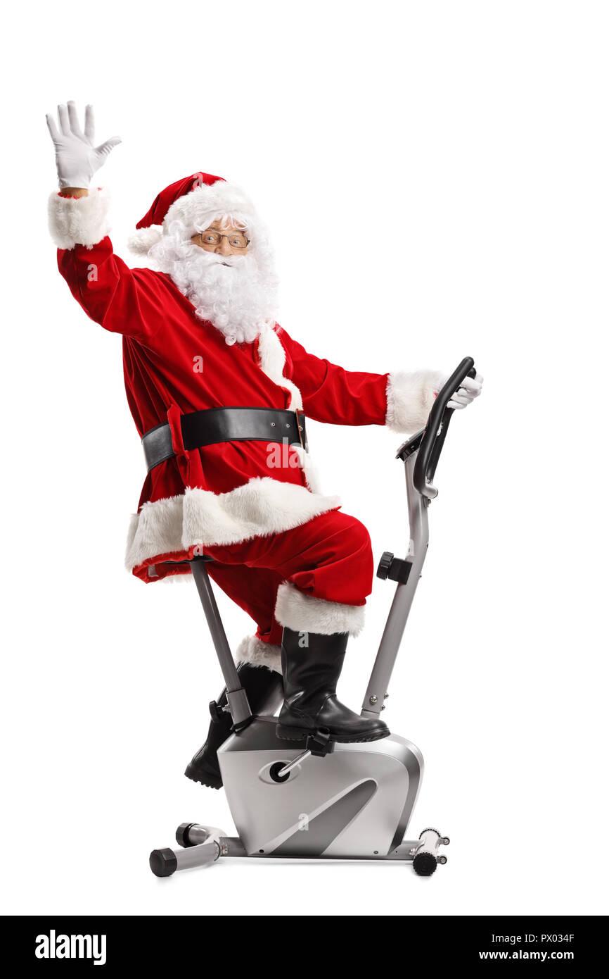 Babbo Natale In Bicicletta.Babbo Natale Che Esercitano Su Una Bicicletta Stazionaria E Agitando