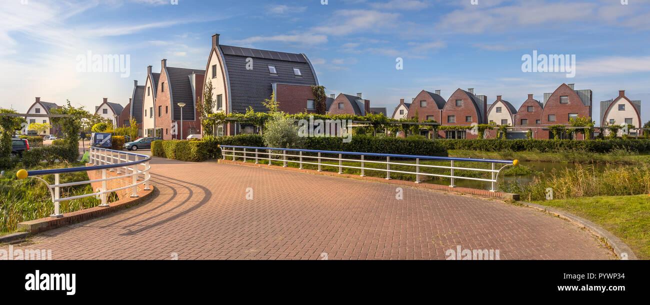 Giardini Per Case Moderne area suburbana con moderne case di famiglia in un bambino
