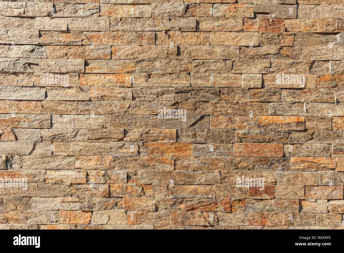 Accento di pietra della parete esterna come superficie di sfondo Immagini Stock