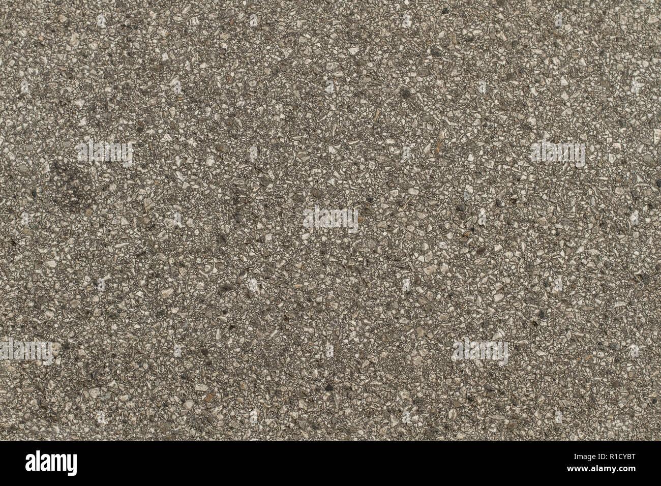 Un grigio asfalto rivestito di piastrelle texture senza saldatura