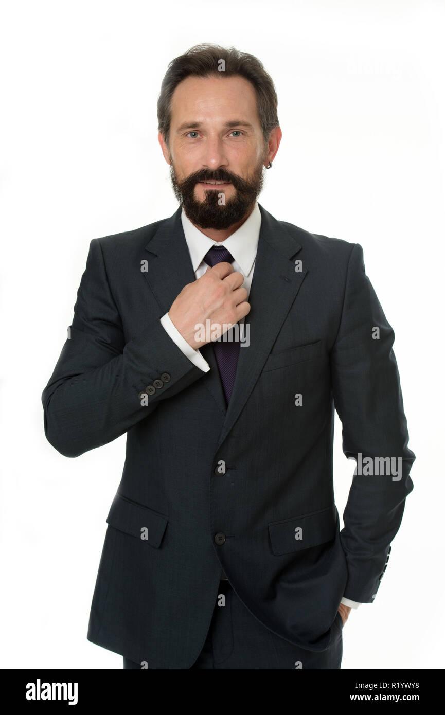 Concetto di imprenditore. Fiducioso imprenditore isolato su bianco. Imprenditore barbuto in abbigliamento formale. Imprenditore di successo con lo stile elegante. Il profitto in azienda. Immagini Stock