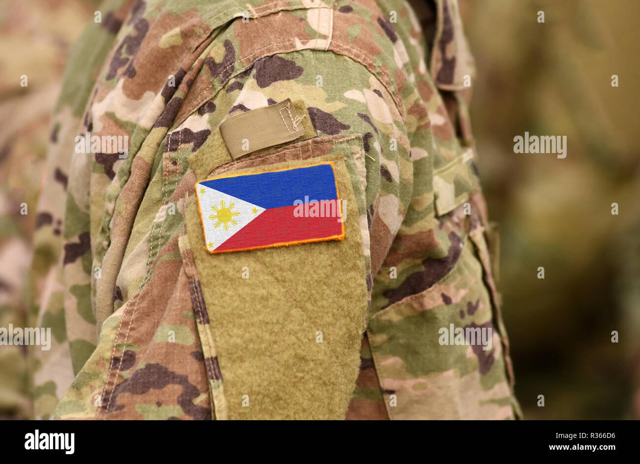 Bandiera delle Filippine sul braccio di soldati. Filippine truppe (collage) Immagini Stock