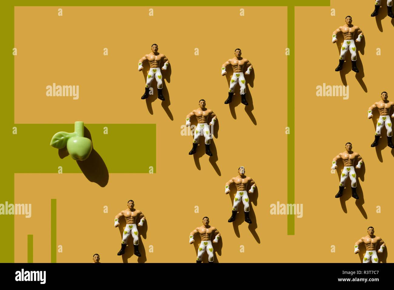 3D Rendering, uomo forte con cuore verde lottatore pantaloni e fake apple, ripetizione Immagini Stock