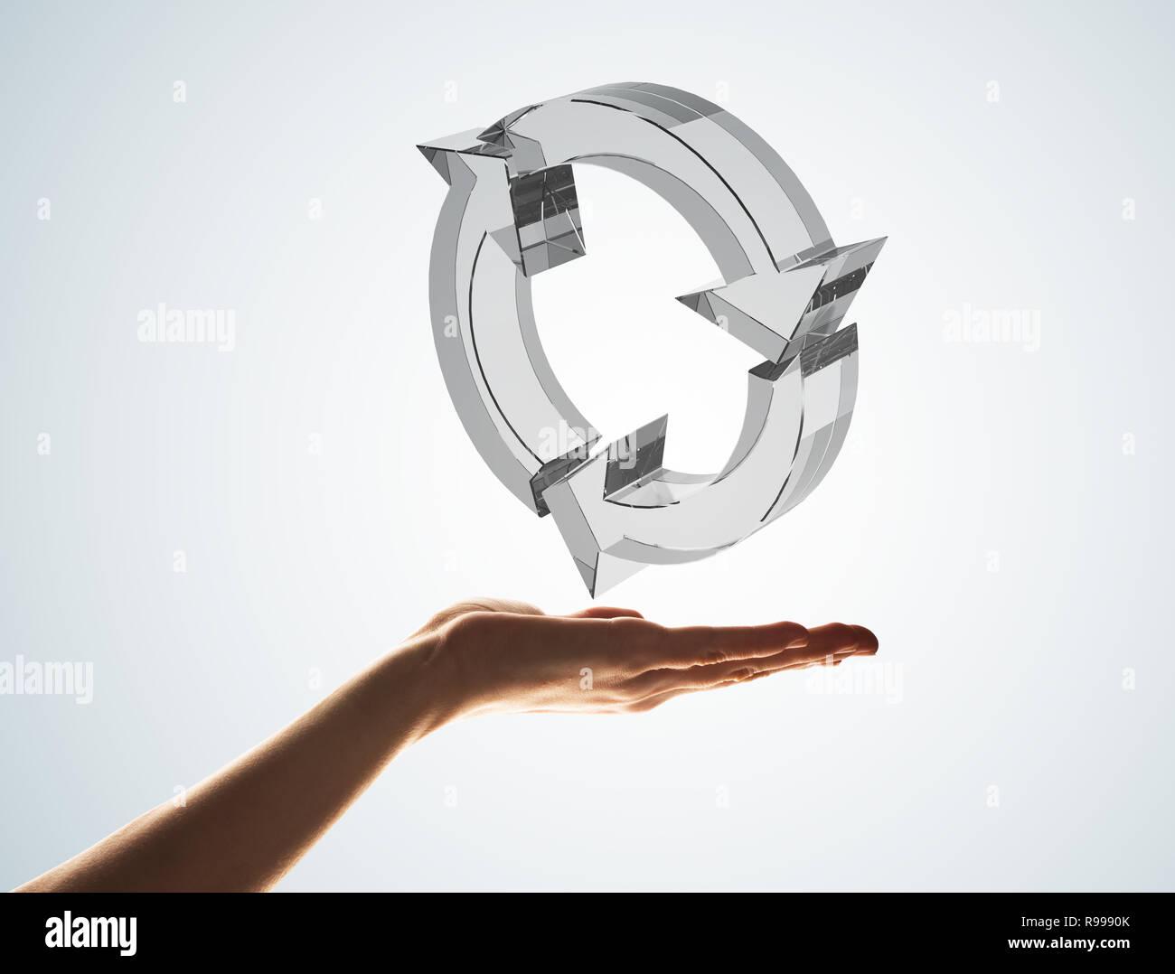 Concetto di riutilizzare e riciclare presentato da icona di vetro in palm Immagini Stock