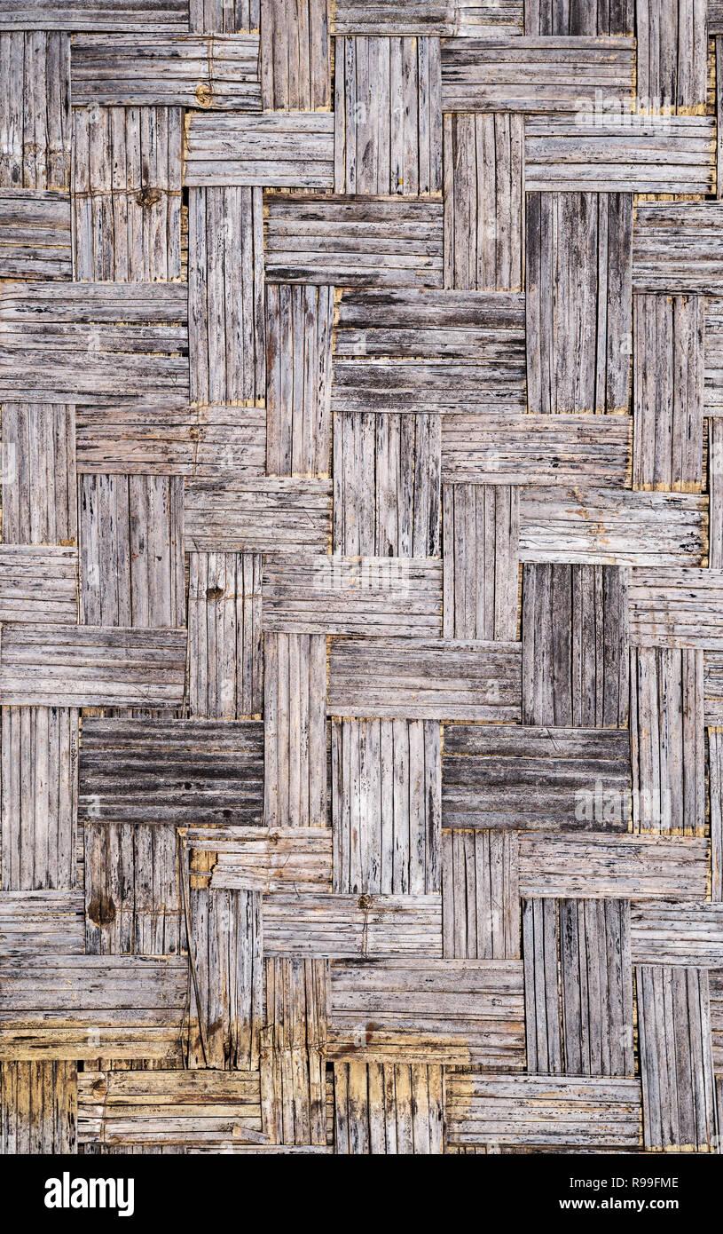 Il vecchio gray distressed grunge tappetino di bambù texture di sfondo Immagini Stock