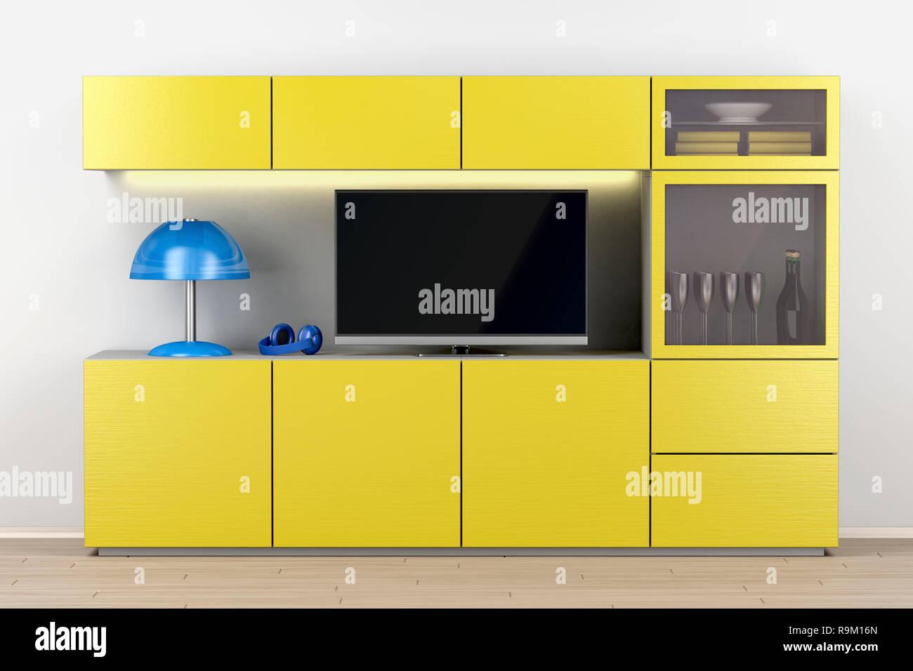 Tv a schermo piatto di grandi dimensioni sul cabinet del ...