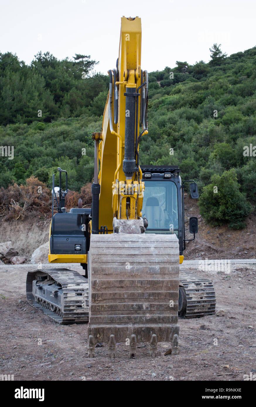 Escavatore a sito in costruzione Foto Stock