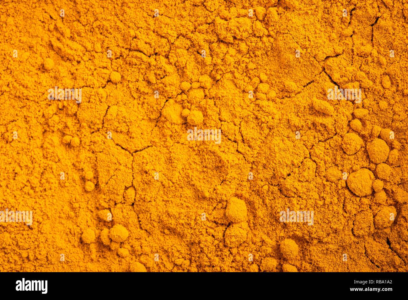 Curcuma (Curcuma longa) sfondo in polvere Immagini Stock